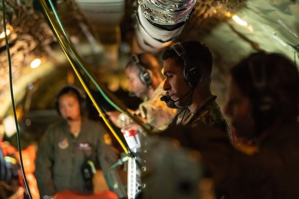 Airmen from the 18th Aeromedical Evacuation Squadron go over their electronic flight books onboard a KC-135 Stratotanker during an exercise May 8th, 2019, out of Kadena Air Base, Japan. The 18th AES maintains a forward operating presence and supports medical contingencies in a free-and-open Indo-Pacific. (U.S. Air Force photo by Airman 1st Class Matthew Seefeldt)