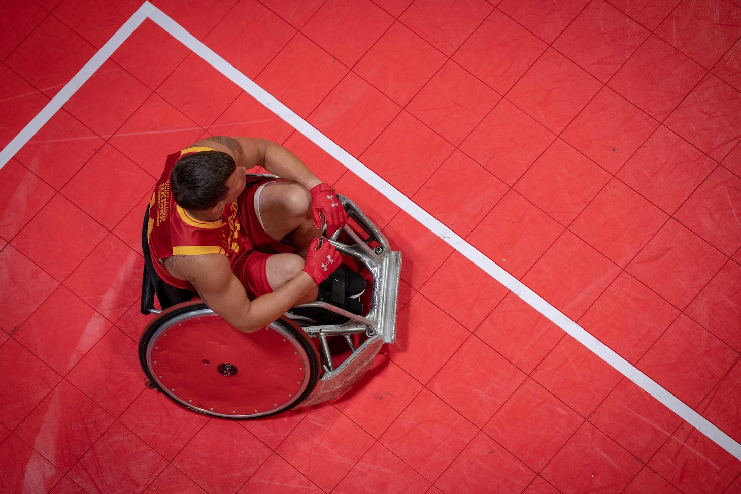 Overhead photo of a Wounded Warrior prepares for a wheelchair rugby match during the 2019 DoD Warrior Games in Tampa, Florida.