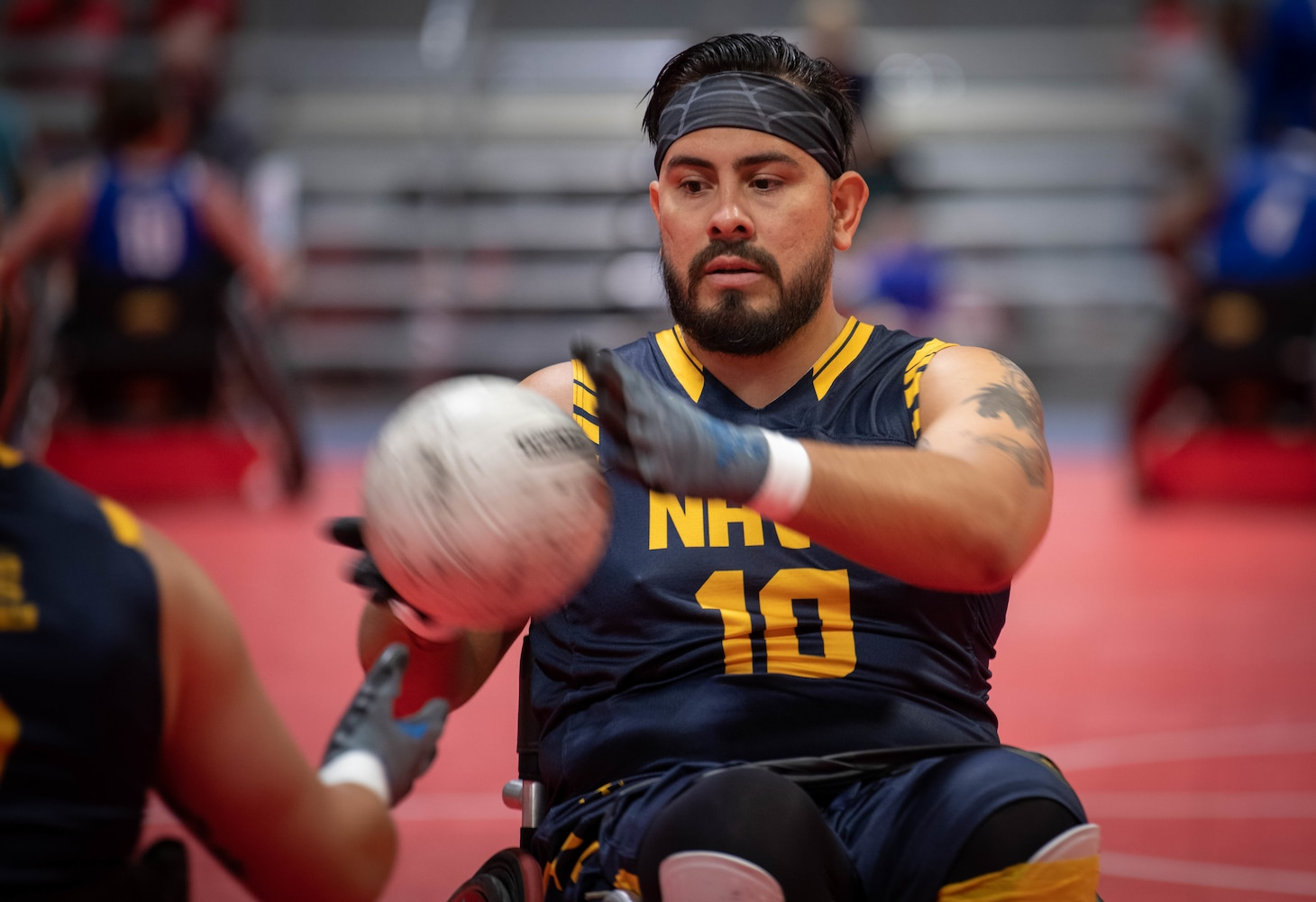 Emmanuel Gonzalez, a Team Navy Wounded Warrior, passes the ball during the 2019 DoD Warrior Games wheelchair rugby game.