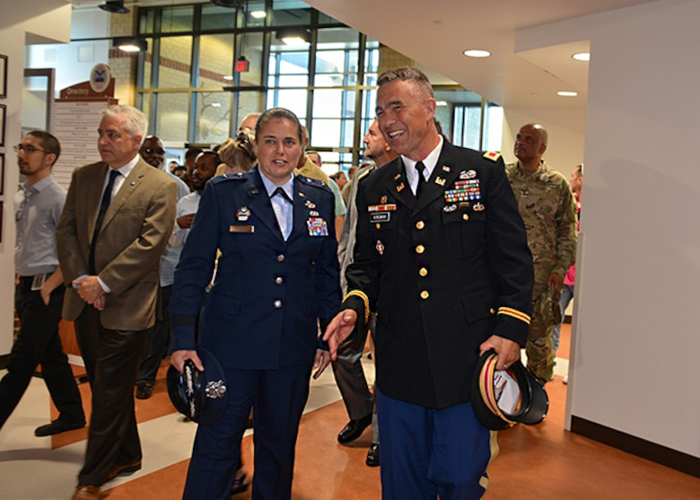 Brig Gen Hurry and Col Kinsman walk into DLA Aviation Operations Center