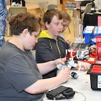IMAGE: KING GEORGE. Va. (June 26, 2019) - Middle school students build a robot at the 2019 Naval Surface Warfare Center Dahlgren Division (NSWCDD)-sponsored Navy science, technology, engineering, and mathematics (STEM) Summer Academy, held June 24-28. They are among 70 middle school students who are developing their teamwork and problem-solving skills in math and science while partnering with a teacher and an NSWCDD scientist or engineer. The STEM Summer 'campers' will deploy the robots they design, build, and program to respond to 10 missions - including the delivery of humanitarian aid, rotating troops and transporting an electromagnetic railgun to the deck of a Navy ship – by the end of the week-long academy.