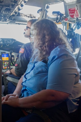 A team member with the dining facility at Grissom Air Reserve Base observes pilots in the flight deck during a refueling in one of Grissom's KC-135R Stratotankers, June 25, 2019. Services support staff from throughout the base got a firsthand look at the mission they help support at Grissom during an employee incentive flight.