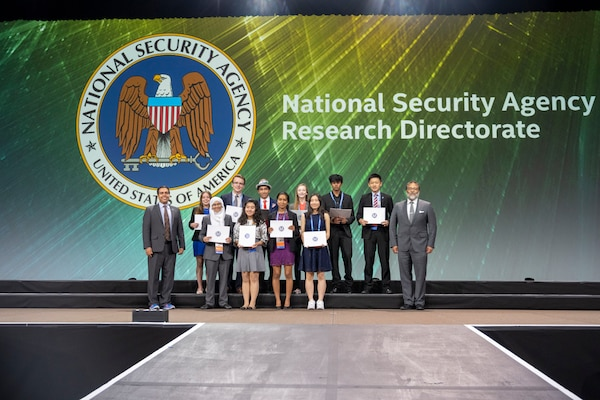 NSA ISEF 2019 Awards. Ten student award recipients stand between representatives from NSA.