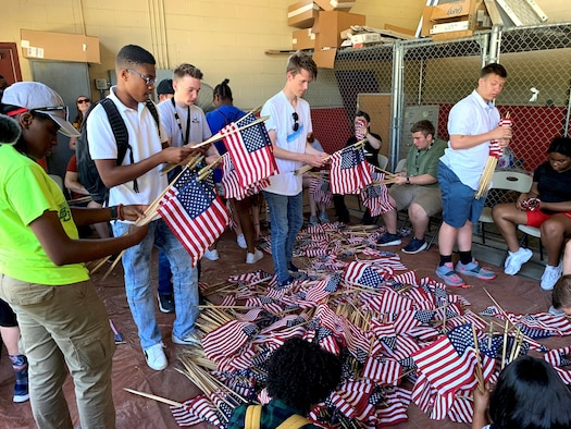 Attendees of the 2019 Youth of the Year Summit gather, roll and store American flags at the Fort Sam Houston Cemetery June 19. During their week in Texas, about 60 teens from across the Air Force took part in a variety of activities focused on teambuilding, leadership, community service and personal growth. The Air Force, through the Air Force Services Center, partners with the Boys and Girls Clubs of America to offer the Youth of the Year program.