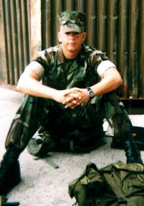 Lance Cpl. Ryan Allen, Motor Transport Operator, sits on the ground in 2001, at Ft. Leornardwood, Mo.
