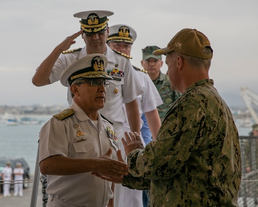 Ecuadorian Navy Rear Admiral Amilcar Villavicencio, commander of naval operations (left) is greeted by Capt. Kevin Buckley.
