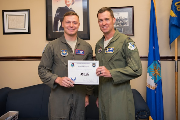 "First Lieutenant Brian Kruchkow, 434th Flying Training Squadron T-6A Texan II instructor pilot, was chosen by wing leadership to be the ""XLer"" of the week, for the week of June 17, 2019, at Laughlin Air Force Base, Texas. The ""XLer"" award, presented by Col. Todd Dyer, 47th Flying Training Wing vice commander, is given to those who consistently make outstanding contributions to their unit and the Laughlin mission. (U.S. Air Force photo by Airman 1st Class Marco A. Gomez)"