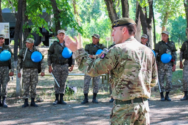 A British Army soldier instructs Kazakhstani soldiers how to respond to a crowd control situation, June 20, 2019, during the field academics phase of Steppe Eagle 19. During the exercise, the British Army taught the Kazakhstanis, Tajikistanis, the U.S., and Kyrgyzstanis how to maintain public order or respond to escalating tensions. Steppe Eagle 19 is an annual U.S. Army Central-led exercise that promotes regional stability and interoperability in the Central and South Asia region.(U.S. Army photo by Maj. Kevin Sandell)