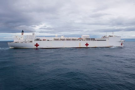 The hospital ship USNS Comfort (T-AH 20) transits the Pacific Ocean.