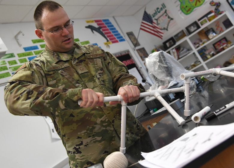 U.S. Air Force Master Sgt. Dell-Ray Sackett, 338th Training Squadron assistant flight chief, assembles a pvc pipe base for a jet propulsion laboratory stomp rocket experiment during the Biloxi Public Schools Science, Technology, Engineering and Mathematics Summer Camp program at Biloxi High School in Biloxi, Mississippi, June 25, 2019. The four-day STEM summer program teaches first through seventh grade students skills for future careers and fosters valuable life skills like problem solving, creativity and collaboration. Keesler personnel volunteered their time to lead instructions on various projects. (U.S. Air Force photo by Kemberly Groue)