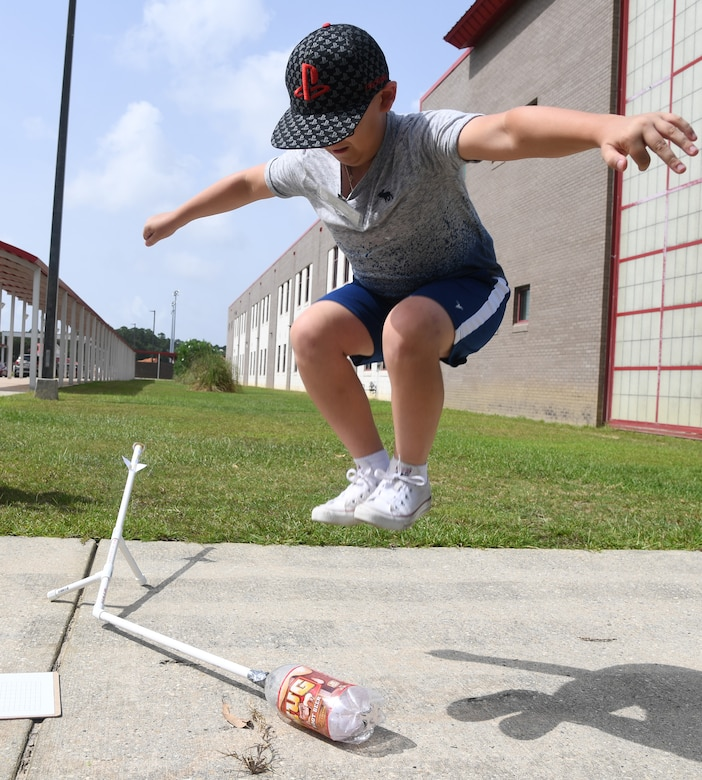 Michael Howell, Biloxi Junior High School seventh grader, launches a jet propulsion laboratory stomp rocket during the Biloxi Public Schools Science, Technology, Engineering and Mathematics Summer Camp program at Biloxi High School in Biloxi, Mississippi, June 25, 2019. The four-day STEM summer program teaches first through seventh grade students skills for future careers and fosters valuable life skills like problem solving, creativity and collaboration. Keesler personnel volunteered their time to lead instructions on various projects. (U.S. Air Force photo by Kemberly Groue)