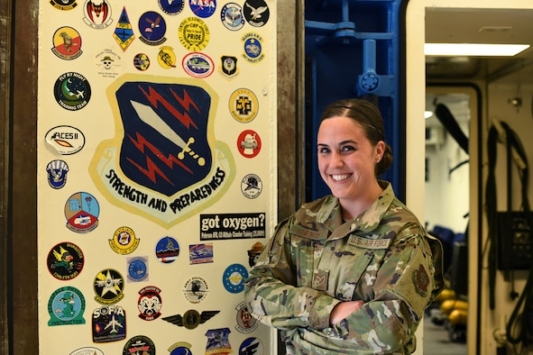 PETERSON AIR FORCE BASE, Colo. — Senior Airman Siara Pinick, a 21st Aerospace Medicine Squadron aerospace and operational physiology technician, poses in front of an altitude chamber May 17, 2019, Peterson Air Force Base, Colorado. Pinick was the winner of the Air Force Medical Service Aerospace and Operational Physiology Airman of the Year award. (U.S. Air Force photo by Airman 1st Class Andrew J. Bertain)