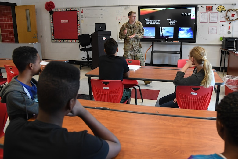 U.S. Air Force Tech. Sgt. Luke Bowersox, 335th Training Squadron army weather forecaster, delivers a weather forecasting brief during the Biloxi Public Schools Science, Technology, Engineering and Mathematics Summer Camp program at Biloxi High School in Biloxi, Mississippi, June 25, 2019. The four-day STEM summer program teaches first through seventh grade students skills for future careers and fosters valuable life skills like problem solving, creativity and collaboration. Keesler personnel volunteered their time to lead instructions on various projects. (U.S. Air Force photo by Kemberly Groue)