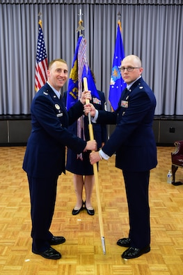 CLEAR AIR FORCE STATION, Alaska--Col. Matthew Cantore (left), 21st Operations Group commander, passes the unit guidon to Lt. Col. Shawn Lee, during the 13th Space Warning Squadron change of command ceremony at Clear Air Force Station, Alaska, June 20, 2019. Lee assumed command of the interior Alaska unit, replacing Lt. Col. Jeffrey Rutherford, who has completed his tour of duty in Alaska and will be assigned to the 21st OG, Peterson Air Force Base, Colorado. (U.S. Air National Guard photo by Senior Master Sgt. Paul Mann)