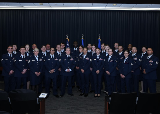 PETERSON AIR FORCE BASE, Colo.—Twenty-eight Airmen from the Front Range graduate from the Community College of the Air Force June 19, 2019 at the Summit Center on Peterson Air Force Base, Colorado. The college annually awards over 22,000 associate degrees in applied science, seeking to aid the Air Force enlisted corps in personal and professional growth. (U.S. Air Force photo by Airman 1st Class Andrew J. Bertain)