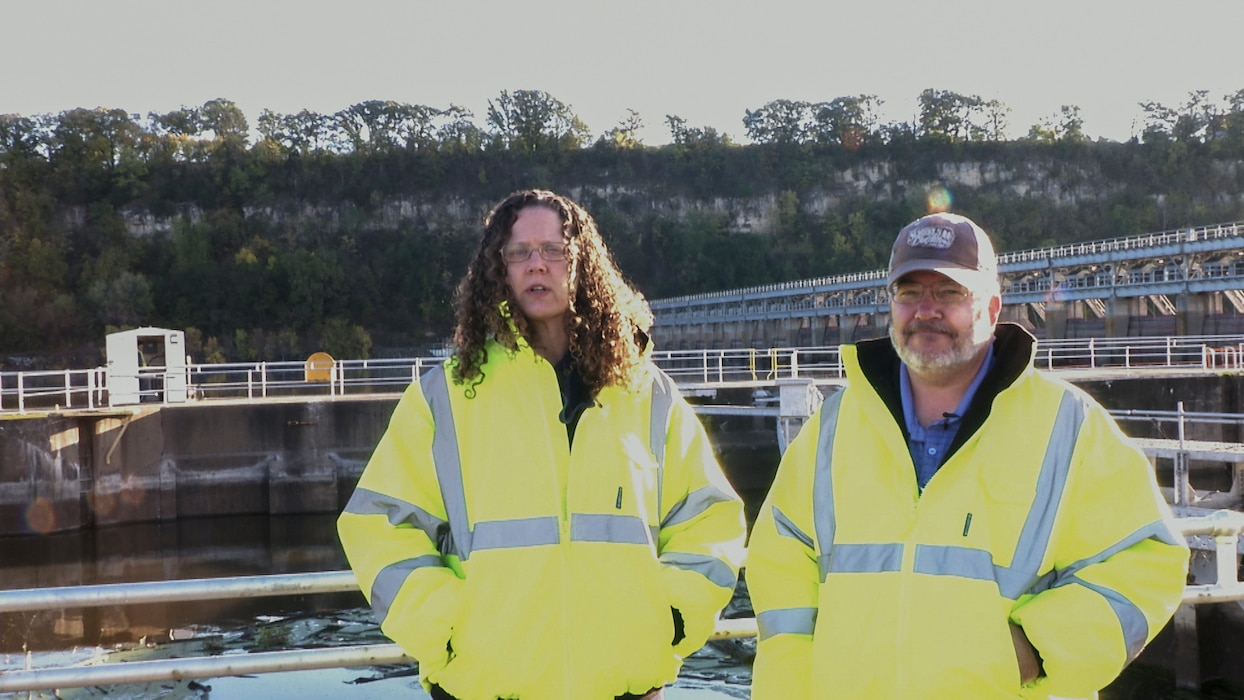 safety officers pose at lock and dam