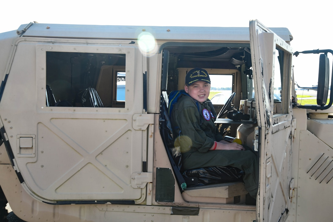 O'Rian Jolley, The Check-6 Foundation pilot for a day, sits in a Humvee on Joint Base Andrews, June 26, 2019. Diagnosed with hydrocephalus, severe gastro-esophageal reflux and most recently an extremely rare primary carnitine deficiency and mitochondrial diseases of the brain, O'Rian was selected to be an honorary pilot to experience a day at JBA and the National Harbor. O'Rian wants to someday serve his country as an Aviation Survival Technician in the US Coast Guard. (U.S. Air National Guard photo by Erica Flores)