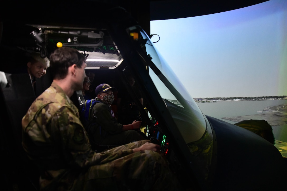 O'Rian Jolley, The Check-6 Foundation pilot for a day, flies a UH-1 simulator at the 1st Helicopter Squadron on Joint Base Andrews, June 26, 2019. O'Rian is the 27th Pilot for a Day at JBA. When he isn't working to reach his goal of being a US Coast Guard rescue swimmer by routinely swimming and learning about the career, he raises money for research and awareness of mitochondrial diseases. He does this by creating and selling paracord 'Hope Bracelets' and giving them out for donations to his cause. He has so far raised over $1,000 for Children's National Medical Center in Washington, DC. (U.S. Air National Guard photo by Erica Flores)