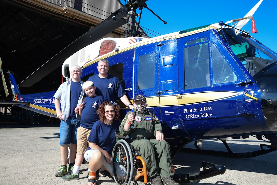O'Rian Jolley, The Check-6 Foundation pilot for a day, and his family visit the 1st Helicopter Squadron on Joint Base Andrews, June 26, 2019. Diagnosed with hydrocephalus, severe gastro-esophageal reflux and most recently an extremely rare primary carnitine deficiency and mitochondrial diseases of the brain, O'Rian was selected to be an honorary pilot to experience a day at JBA and the National Harbor, with the help of The Check-6 Foundation and volunteer military and civilian members who work on JBA. (U.S. Air National Guard photo by Erica Flores)