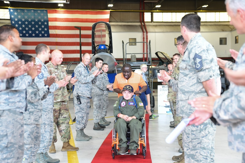 O'Rian Jolley, The Check-6 Foundation pilot for a day, leaves the 113th Wing after seeing a DC Air National Guard F-16 on Joint Base Andrews, June 26, 2019. O'Rian was honored by having his name put on the F16 he toured. (U.S. Air National Guard photo by Erica Flores)