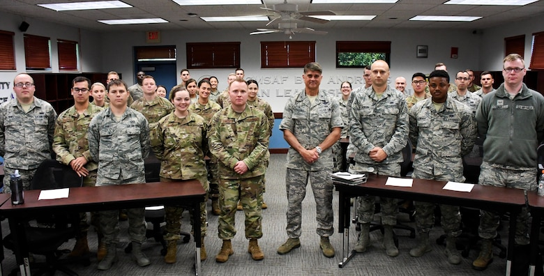 Commander of the 932nd Airlift Wing, Col. Glenn Collins, fourth from right, made a visit to the Airman Leadership School on June 11, 2019, at Scott Air Force Base, Ill.  He and Chief Master Sgt. Darren Wiseman (fifth from left), the 932nd Inspector General Superintendent, spoke to future non-commissioned officers on leading, responsibility, and taking care of their units.  (U.S. Air Force photo by Lt. Col. Stan Paregien)