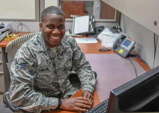 Senior Airman Robert Lawson, a knowledge operations specialist with the 910th Communications Squadron here, poses for a photo at his desk on May 14, 2019.