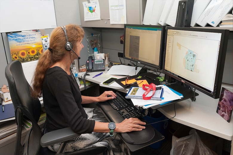 Christiana Hewitt, a BRAC environmental coordinator with the Air Force Civil Engineer Center's Base Realignment and Closure program, accesses GeoBase at Joint Base San Antonio-Lackland, Texas, June 20, 2019. A BRAC team developed and transferred geospatial data for 39 BRAC installations onto the Air Force GeoBase, which centralizes all geospatial data and utilizes modern information procedures and technology to display and query data quickly and accurately. (U.S. Air Force photo by Malcolm McClendon)