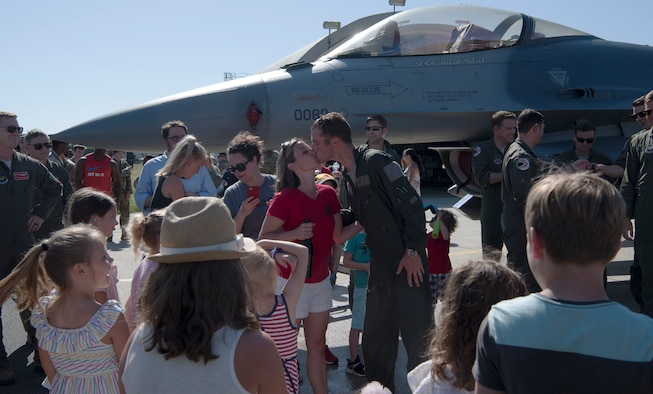 Family, friends, and co-workers gathered on the flightline to congratulate Richard and wish him well as he moves on to his next base