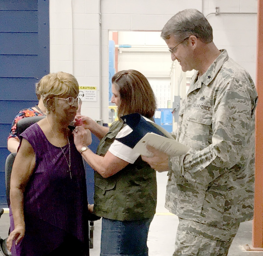 Donnetta Martin, 547th Propulsion Maintenance Group, received a 50-year service pin from Jetta Reed with the Oklahoma City Air Logistics Complex and OC-ALC Commander Brig. Gen. Chris Hill. (Courtesy photo/Susan Johnson)