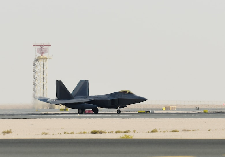 A photo of an F-22 taxiing down a runway.