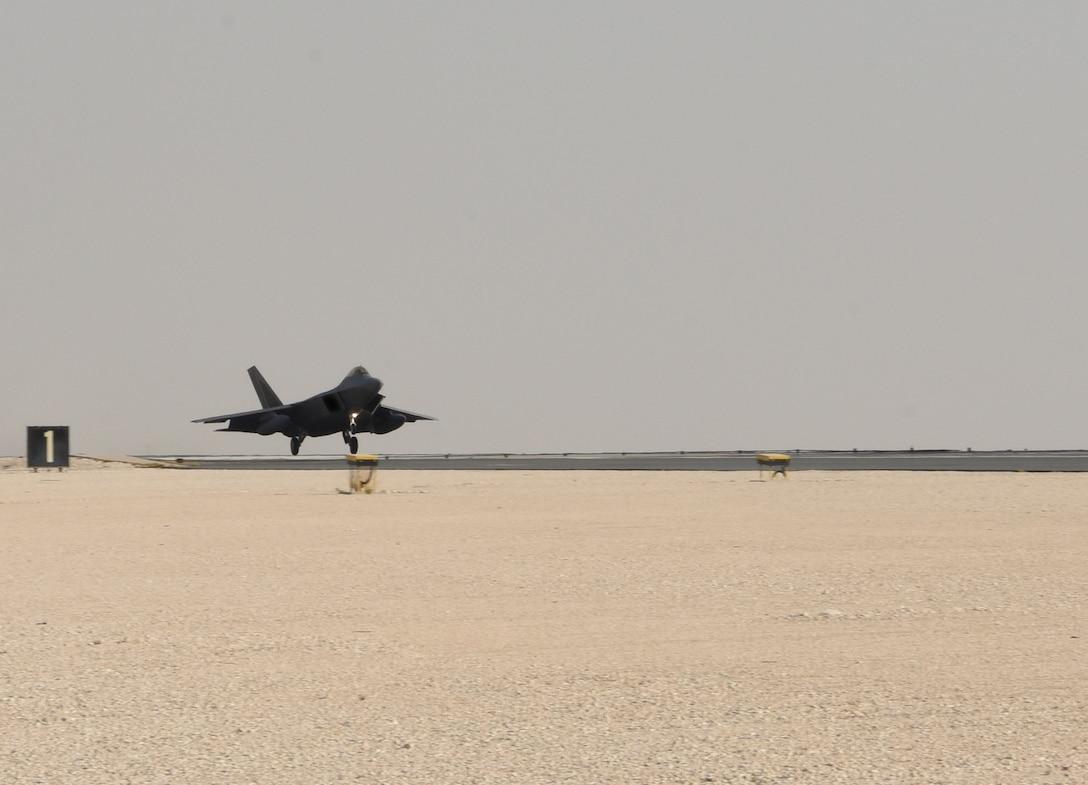 A photo of an F-22 landing.