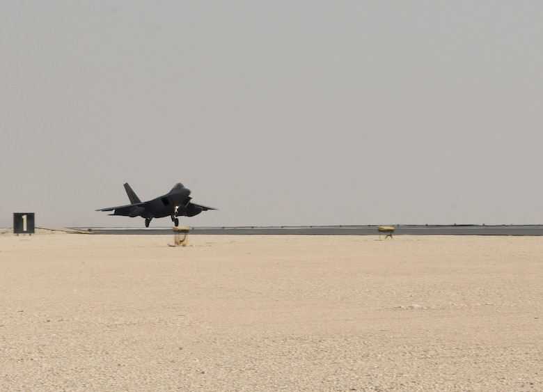 A photo of an F-22 landing.