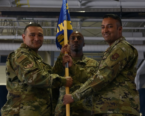 Colonel Brian Rico, 90th Maintenance Group commander, passes the guidon to Maj. Aaron Taylor, 790th Maintenance Squadron incoming commander, during the 790ths MXS change of command ceremony June 27, 2019, on F.E. Warren Air Force Base, Wyo. The ceremony signified the transition of command from Maj. Christine Hernandez to Taylor (U.S. Air Force photo by Senior Airman Nicole Reed)