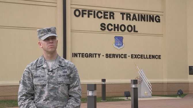 U.S. Air Force Capt. Dan Hochhalter, 24th Training Squadron member, stands  in front of the Officer Training School building on Maxwell Air Force Base, Alabama.