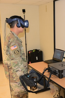 A cadre member of the 32nd Medical Brigade, Heath Readiness Center of Excellence, participates in a HaptX usability study using Tactical Combat Casualty Care Simulation, or TC3Sim, medical trainer scenarios. The study, funded by Army Futures Command, Simulation and Training Technology Center was conducted June 19-20 at Joint Base San Antonio-Fort Sam Houston.