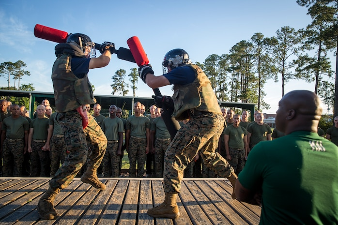 Recruits with Kilo Company, 3rd Recruit Training Battalion, engage pugil sticks at Marine Corps Recruit Depot Parris Island, S.C., June 21, 2019. Body sparring and pugil sticks help recruits apply the fundamentals of Marine Corps martial arts. (U.S. Marine Corps photo by Lance Cpl. Christopher McMurry)
