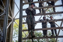 A recruit with Charlie Company, 1st Recruit Training Battalion, practices rappelling on Marine Corps Recruit Depot Parris Island, S.C., June 24, 2019. Recruits rappel from the 47-foot-tall tower wearing a safety harness, helmet and gloves to gain confidence and overcome any fear of heights. (U.S. Marine Corps photo by Lance Cpl. Christopher McMurry)