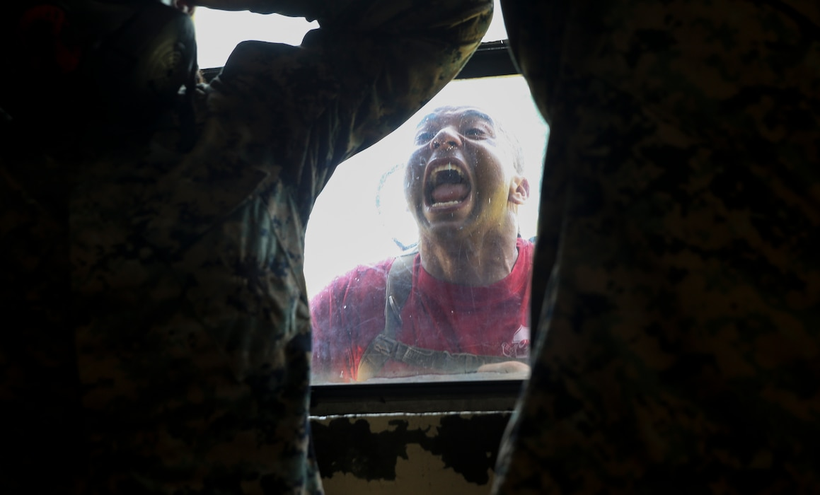 A drill instructor with Charlie Company, 1st Recruit Training Battalion, conducts chemical, biological, radiological, nuclear (CBRN) defense training at Marine Corps Recruit Depot, Parris Island, S.C., June 24, 2019. Training for CBRN defense is an event that recruits must complete in order to become United States Marines. (U.S. Marine Corps photo by Lance Cpl. Ryan Hageali/Released)