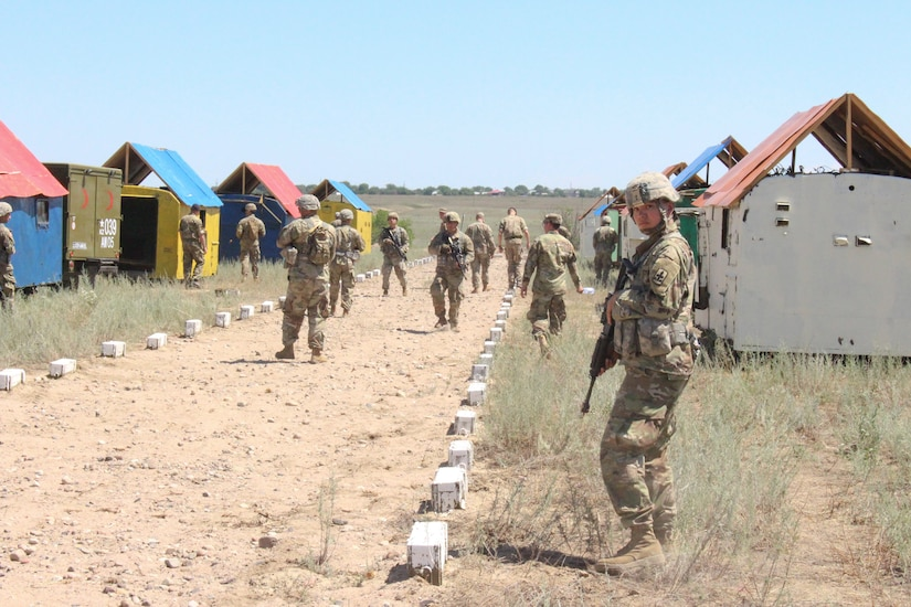 A platoon of U.S. Army Soldiers from the Arizona Army National Guard's 1st Battalion, 158th Infantry Regiment conducts simulated training at Chilekemer Training Area, June 20, 2019, near Almaty, Kazakhstan as part of Steppe Eagle 19. Steppe Eagle 19 is an annual U.S. Army Central-led exercise that promotes regional stability and interoperability in the Central and South Asia region.