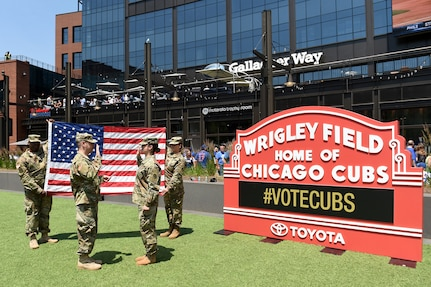 Sgt. Maribel Meraz, assigned to the 85th U.S. Army Reserve Support Command, headquartered in the northwest suburbs of Chicago, reenlists at Gallagher Way, adjacent to the Chicago Cubs Wrigley Field, June 27, 2019, for a third six-years in the Army Reserve.