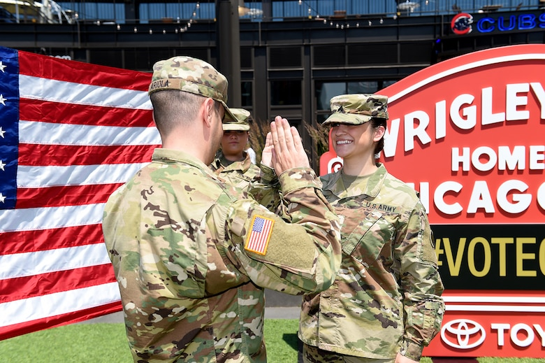 Sgt. Maribel Meraz, assigned to the 85th U.S. Army Reserve Support Command, headquartered in the northwest suburbs of Chicago, states the Oath of Enlistment at Gallagher Way, adjacent to the Chicago Cubs Wrigley Field, June 27, 2019, for a third six-years in the Army Reserve.