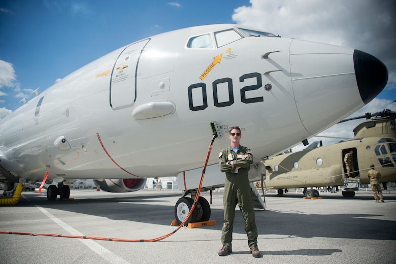 U.S. Navy Lt. Adam Anderson, a mission commander from Patrol Squadron 9, Combat Aircrew 3, stationed at Naval Air Station Whidbey Island, Wash., poses for a photo in front of a P-8A Poseidon from his unit at the Paris Air Show, June 21, 2019. Anderson was one of approximately 130 U.S. military aircrew and support personnel from bases in Europe and the U.S. who participated in the air show. (U.S. Air Force photo by Master Sgt. Eric Burks)