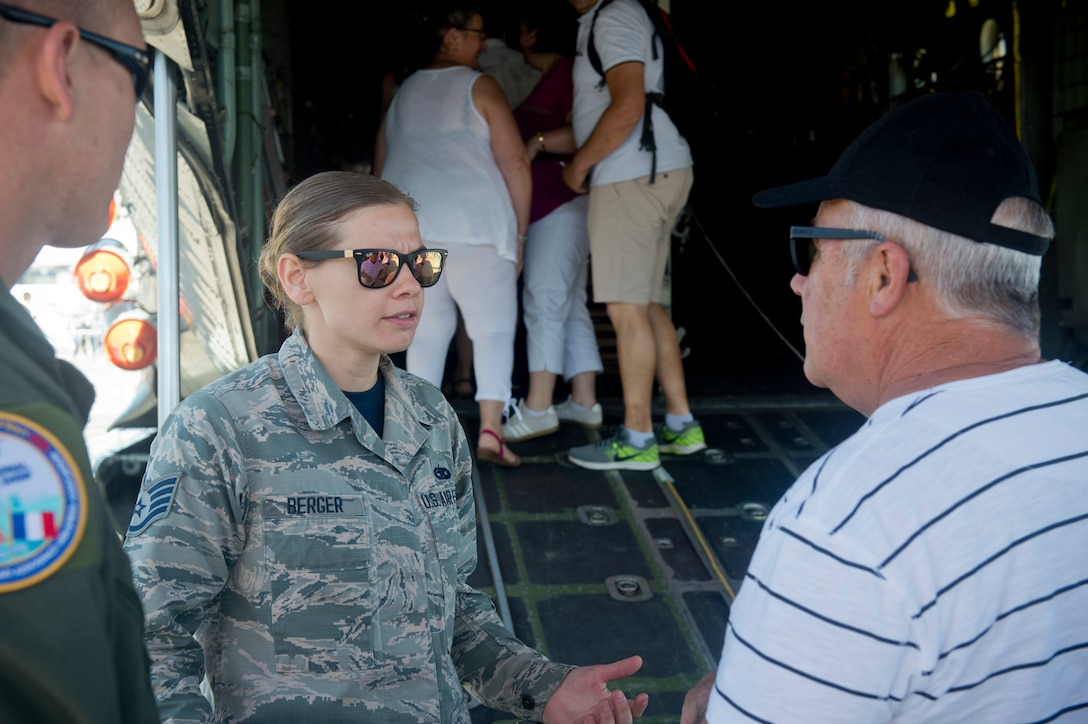 U.S. Air National Guard Staff Sgt. Jennatte Berger, an avionics technician from the 109th Airlift Wing at Stratton Air National Guard Base in Scotia, N.Y., engages with visitors during the Paris Air Show, June 22, 2019. The air show provided a collaborative opportunity to share and strengthen U.S. and strategic international partnerships. (U.S. Air Force photo by Master Sgt. Eric Burks)