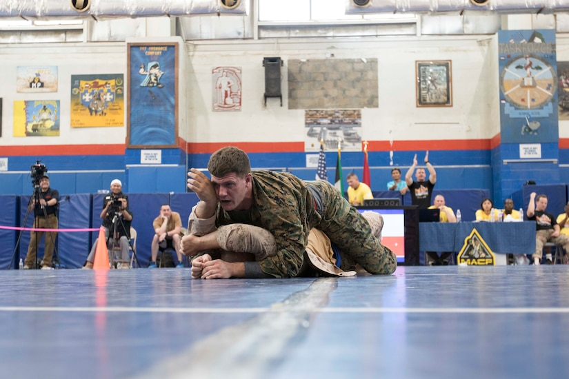 United States Marine Capt. Dylan Grayston, an assistant air officer assigned to the 11th Marine Expeditionary Unit, wins a heavy weight fight during a combatives tournament at Camp Arifjan, Kuwait, June 23, 2019. U.S. Army Central hosts events such as the combatives tournament to strengthen its relationship and build partner capacity with the Kuwaitis. USARCENT operates throughout the Middle East region and appreciates the generosity of the host nation's willingness to maintain bilateral defense relationships.
