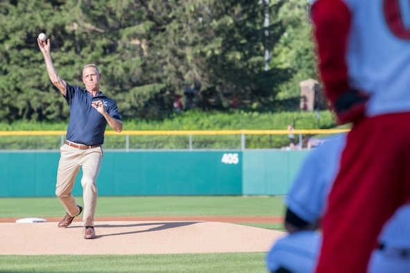 Col. Larry Shaw, 434th Air Refueling Wing commander, winds up to deliver the first pitch June 25, 2019 at an Indianapolis Indians home game. Shaw joined Air Force Reserve recruiters to make a pitch to future Airmen to join the 434th ARW. (U.S. Air Force photo/Benjamin Mota)
