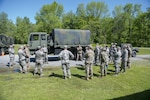 Members assigned to the 158th Fighter Wing discuss the vehicle training portion of the Quick Reaction Force annual training at Camp Ethan Allen Training Site, Jericho, Vt., June 6, 2019. The QRF team is the 'on-call' support providing rapid response to state-level emergencies and natural disasters. (U.S. Air National Guard photo by Tech. Sgt. Garth Dunkel)