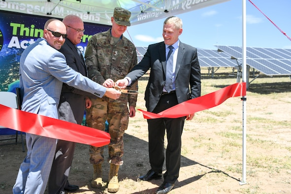 (Left to right) Nickolas King, base energy manager, Harry Briesmaster, 75th Civil Engineer Group director, Col. Jon Eberlan, 75th Air Base Wing commander, and Steven Spanbauer, senior vice president of the Federal Business Unit at Energy Systems Group, cut the ribbon June 27, 2019, during a ceremony at Hill Air Force Base, Utah, announcing the completion of the new ground-mounted solar array. The array was installed through an energy savings performance contract, which means there is no upfront cost to the government. (U.S. Air Force photo by Cynthia Griggs)