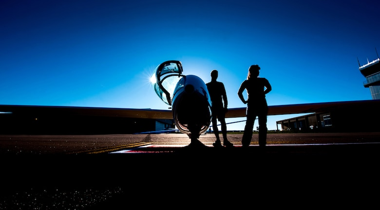 U.S. Air Force Academy cadets stand by for another plane to land