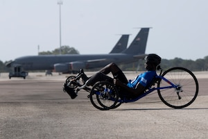 Air Force Staff Sgt. races a recumbent cycle during the 2019 DoD Warrior Games