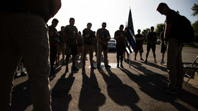 Participants during the 12th Annual Balmer Ruck March observe a moment of silence June 7, 2019, at Hill Air Force Base, Utah. The event is held each year to honor Special Agent Ryan Balmer who was killed in action June 5, 2007, at Kirkuk Iraq. Balmer was a member of the AFOSI Detachment 113 at Hill AFB. (U.S. Air Force photo by R. Nial Bradshaw)